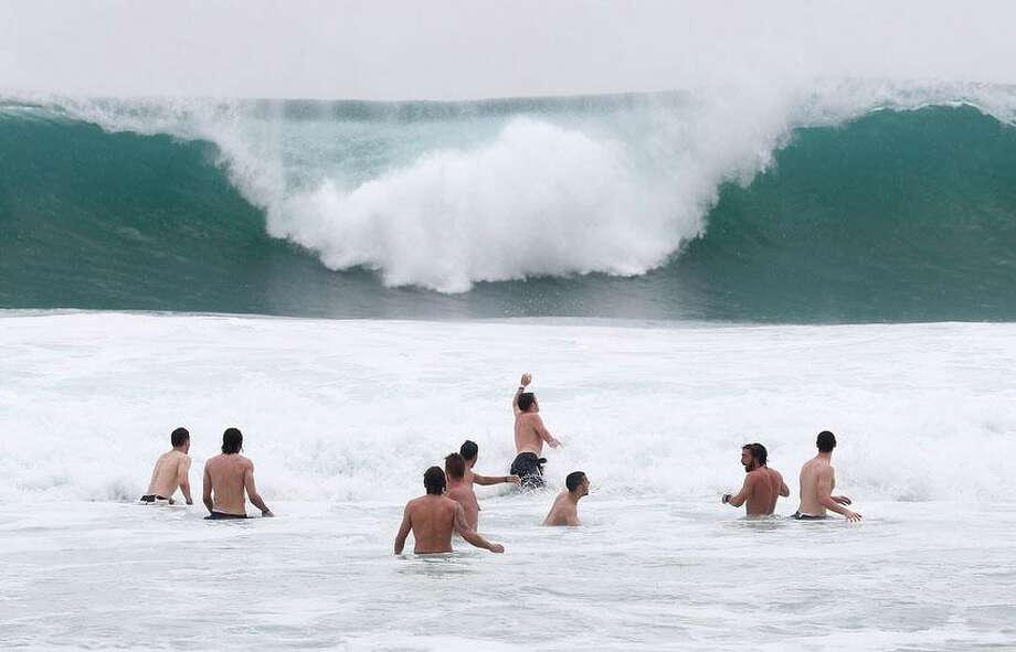 Italy players relax in the breakers of the Atlantic ocean at the soccer Confederations Cup in Rio de Janeiro, Brazil, Monday, June 17, 2013. (AP Photo/Antonio Calanni) Photo: ASSOCIATED PRESS / AP2013