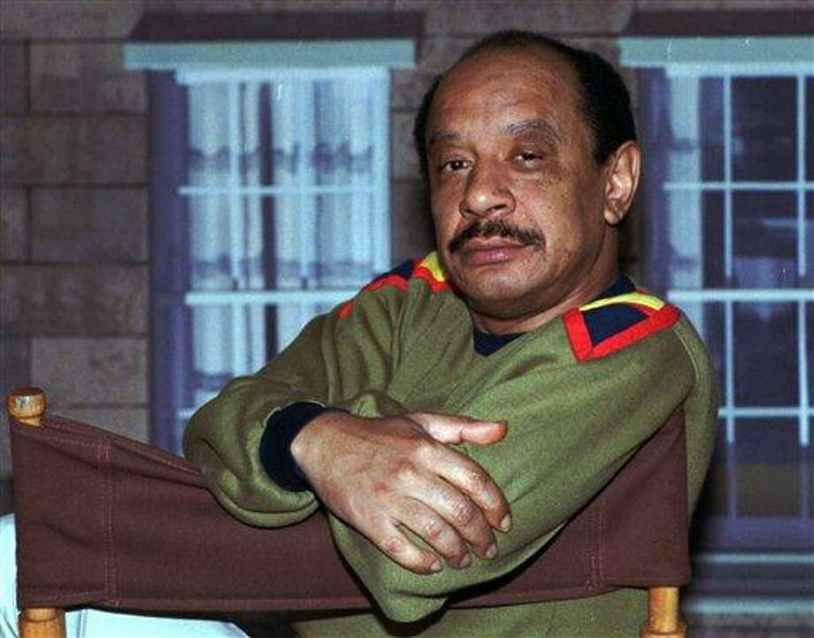 "In this 1986 file photo, actor Sherman Hemsley poses for a photo in Los Angeles. Hemsley, the actor who made the irascible, bigoted George Jefferson of ""The Jeffersons"" one of television's most memorable characters and a symbol for urban upward mobility, was found dead Tuesday at his El Paso, Texas, home. He was 74.  (AP photo/Nick Ut, File) Photo: AP / AP"
