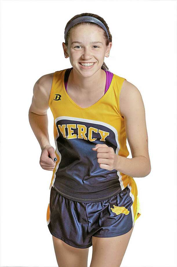 Mercy senior Kaleigh Roberts will lead the newly crowned SCC champion Tigers into tomorrow's Class L state finals meet at Manchester's Wickham Park. Catherine Avalone - The Middletown Press Photo: Journal Register Co. / TheMiddletownPress