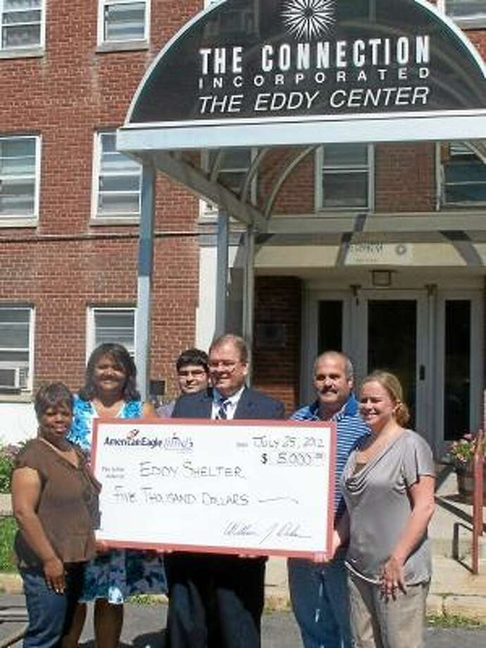 Jim Salemi I The Middletown Press American Eagle Federal Credit Union president and CEO Bill Dokas presents the Eddy Shelter with a check for $5,000.