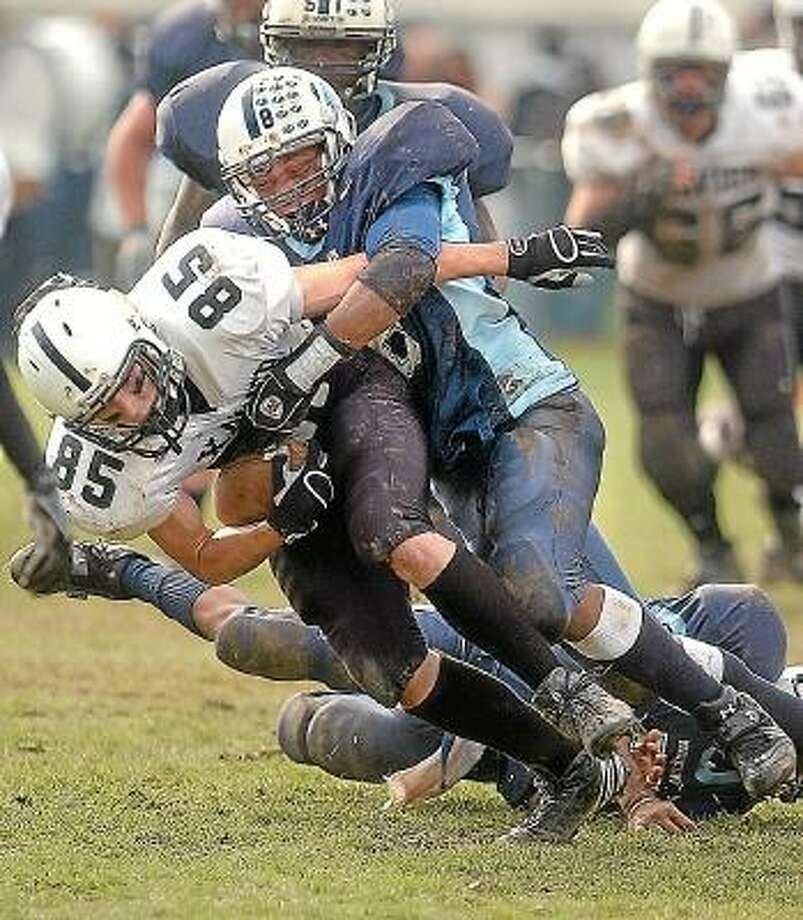 Middletown High linebacker Charles Watson wraps up Xavier High's Danny Darragh after a second quarter reception.  11.22.07 Middletown Press file photo.