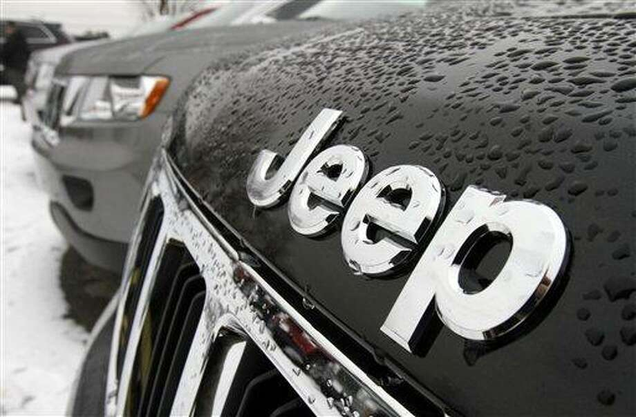 The Chrysler Jeep logo is displayed on a 2012 Jeep Grand Cherokee. Chrysler has posted its first annual net income since 1997. Associated Press Photo: AP / AP