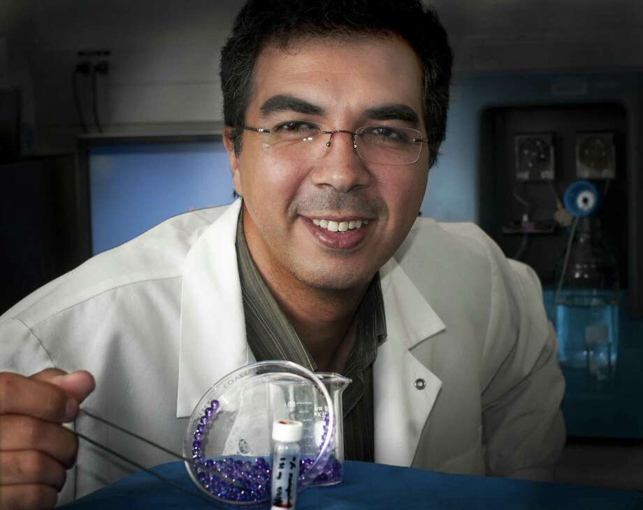 New Haven --Yale Bioengineer, Tarek Fahmy, with a small bottle of nano particles and some gelcaps that represent a much larger than life  example of the characteristics that the particles will exhibit when they are hydrated, and become nanogels.Melanie Stenge/Register