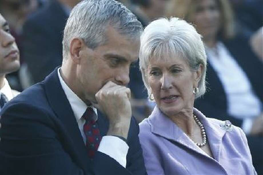 Health and Human Services Secretary Kathleen Sebelius, right, is seated with White House Chief of Staff Denis McDonough as President Barack Obama speaks Monday during an event in the Rose Garden of the White House on the initial rollout of the health care overhaul. Obama acknowledged that the widespread problems with his health care law's rollout are unacceptable, as the administration scrambles to fix the cascade of computer issues. (AP Photo/Charles Dharapak) Photo: AP / AP