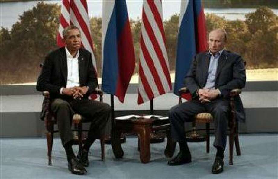 U.S. President Barack Obama (L) meets with Russian President Vladimir Putin during the G8 Summit at Lough Erne in Enniskillen, Northern Ireland June 17. (Kevin Lamarque/Reuters) Photo: REUTERS / X00157