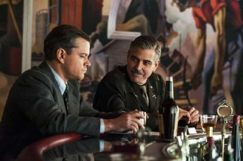 "This film image released by Columbia Pictures shows Matt Damon, left, and George Clooney in ""The Monuments Men."""