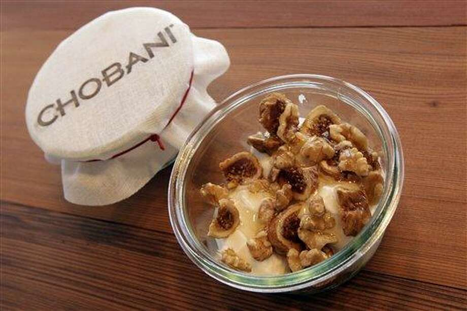 """A bowl of """"Fig + Walnut"""" made with Turkish figs, walnuts, and honey is on display Monday at the Chobani yogurt bar in the Soho neighborhood of New York. Chobani is opening up its first """"yogurt bar"""" in New York City on Wednesday as it looks to strengthen its position in a rapidly growing market. Associated Press Photo: AP / AP"""