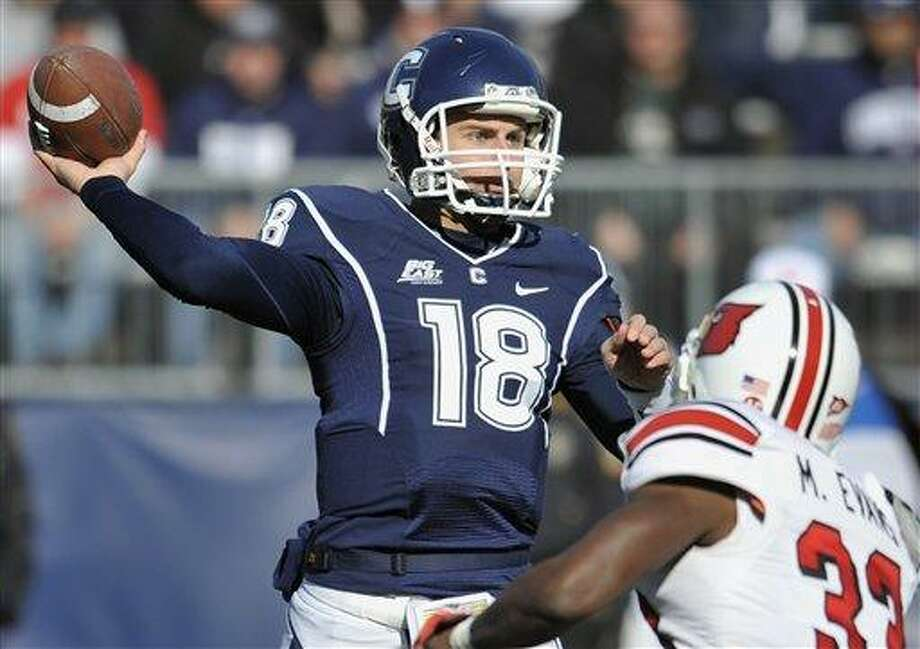 Connecticut's Johnny McEntee throws against Louisville's Mike Evans in the first half of an NCAA college football game at Rentschler Field in East Hartford, Conn., Saturday, Nov. 19, 2011.  Louisville beat Connecticut 34-20. (AP Photo/Jessica Hill) Photo: ASSOCIATED PRESS / AP2011