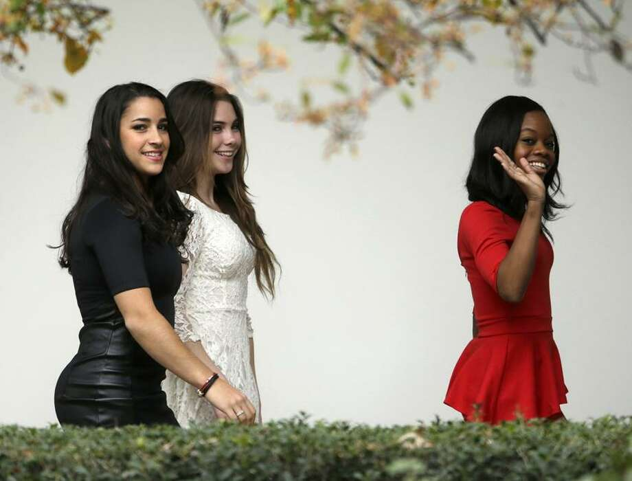 Members of the 2012 Women's Olympic gymnastics team, from left, McKayla Maroney of Long Beach, Calif.;, Jordyn Wieber of DeWitt, Mich.;, and Gabby Douglas of Virginia Beach, Va.; walk in the colonnade of the White House in Washington, Thursday, Nov. 15, 2012, to watch President Barack Obama depart from the South Lawn. Obama had meet with the team earlier in private meeting in the Oval Office. (AP Photo/Pablo Martinez Monsivais) Photo: AP / 2012 AP
