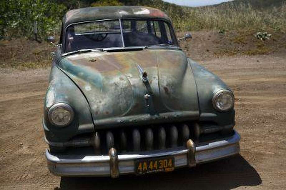 """A 1952 Chrysler Town & Country Wagon, with the front end of a DeSoto grafted on. The automobile is part of owner and head designer of Los Angeles-based custom automobile Icon's """"Derelict"""" series and goes for $190,000. (Bloomberg News/Patrick B. Fallon)"""