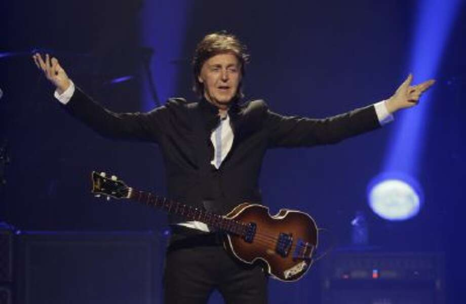 "In this Saturday, May 18, 2013 photo, Paul McCartney performs during the first U.S concert of his ""Out There"" tour, in Orlando, Fla."