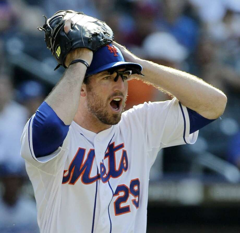 ASSOCIATED PRESS New York Mets first baseman Ike Davis reacts after first base umpire Mike Dimuro called Los Angeles Dodgers' Tony Gwynn Jr., safe on a 12th-inning bunt single in Sunday's game at Citi Field in New York. The Dodgers won 8-3.