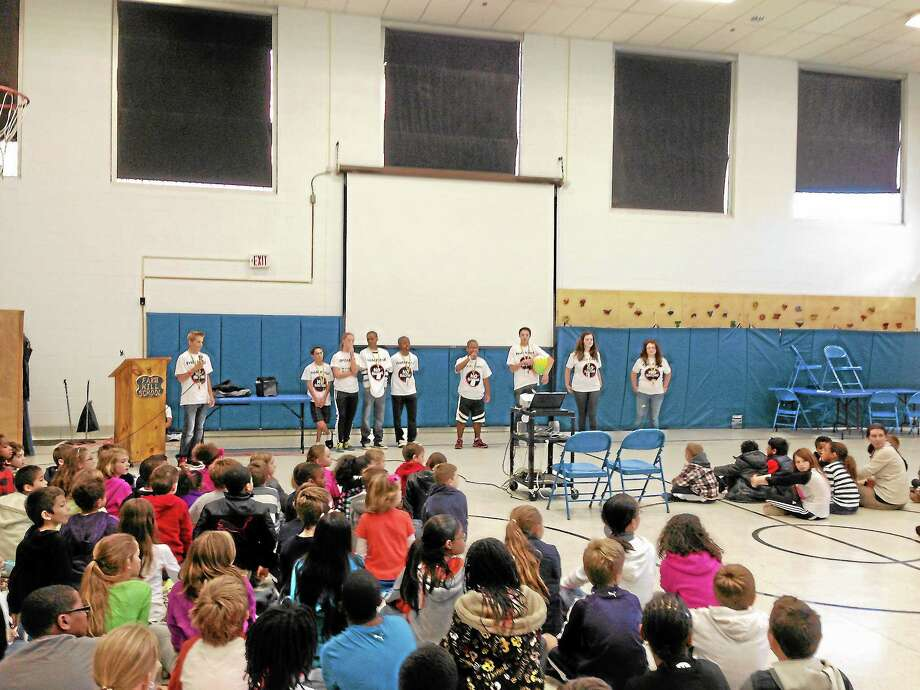The Woodrow Wilson Pride Patrol puts on a skit to show their younger peers at Farm Hill School how name-calling and meanness can hurt for a long time. Photo: Kaitlyn Schroyer - The Middletown Press