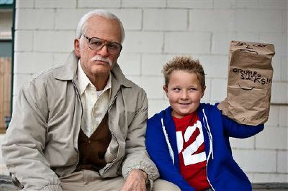 """This photo released by Paramount Pictures shows Johnny Knoxville, left, as Irving Zisman and Jackson Nicoll as Billy in """"Jackass Presents: Bad Grandpa,"""" from Paramount Pictures and MTV Films. Photo: AP / Paramount Pictures"""
