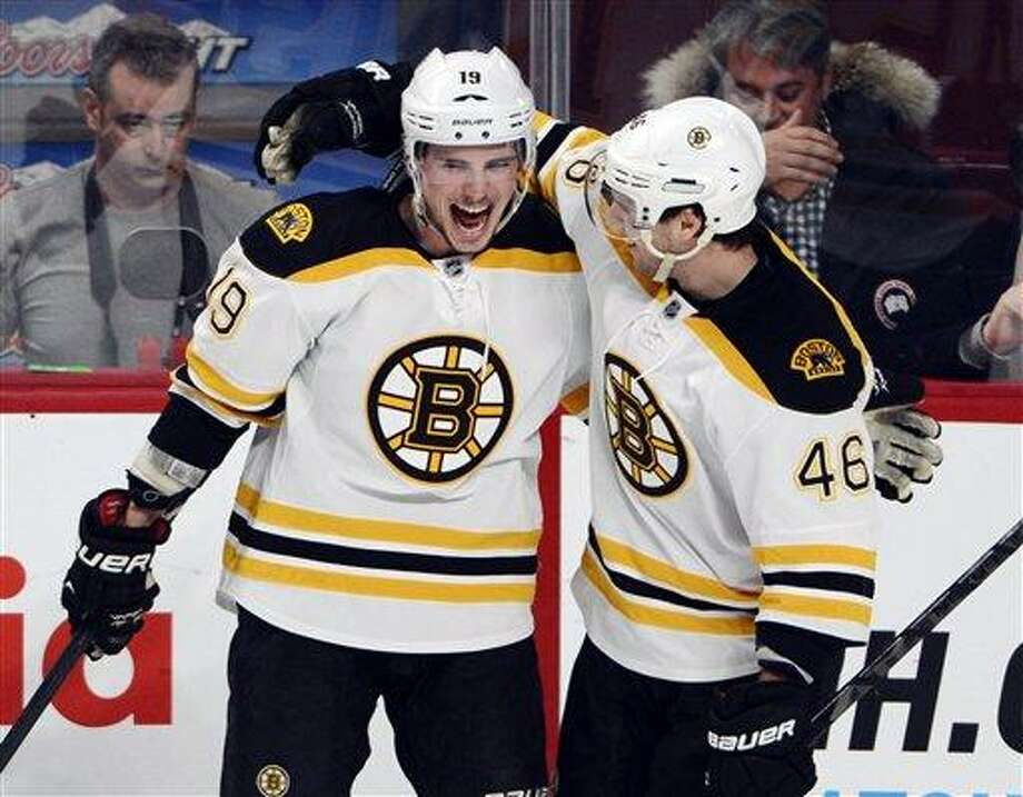 Boston Bruins center Tyler Seguin (19) celebrates with David Krejci (46)after scoring against the Montreal Canadiens during the third period of their NHL hockey game, Wednesday, Feb. 6, 2013, in Montreal. The Bruins won 2-1. (AP Photo/The Canadian Press, Ryan Remiorz) Photo: AP / The Canadian Press