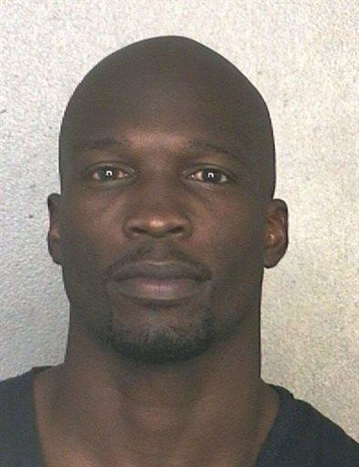 This arrest photo made available by the Broward County Sheriff's Office shows former NFL wide receiver Chad Johnson Monday, May 20, 2013. Johnson has been arrested on charges that he violated probation stemming from an altercation with his now ex-wife, TV reality star Evelyn Lozada. A Broward County judge ordered Johnson jailed Monday until he posts a $1,000 bond.  (AP Photo/Broward County Sheriff's Office) Photo: AP / Broward County Sheriff's Office