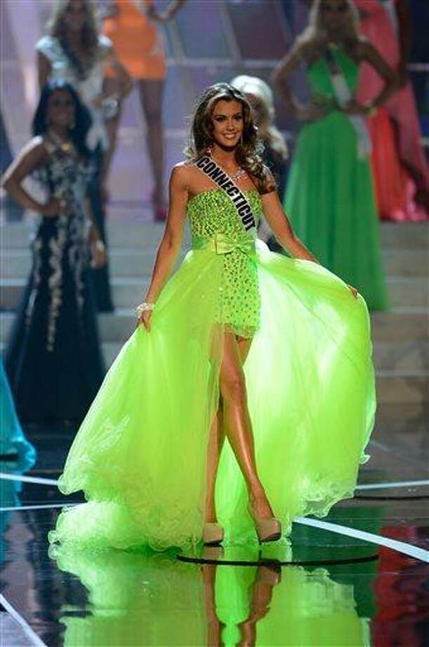 Miss Connecticut Erin Brady, from Glastonbury, Conn., walks the runway during the introductions of the Miss USA 2013 pageant, Sunday, June 16, 2013, in Las Vegas. (AP Photo/Jeff Bottari) Photo: AP / AP