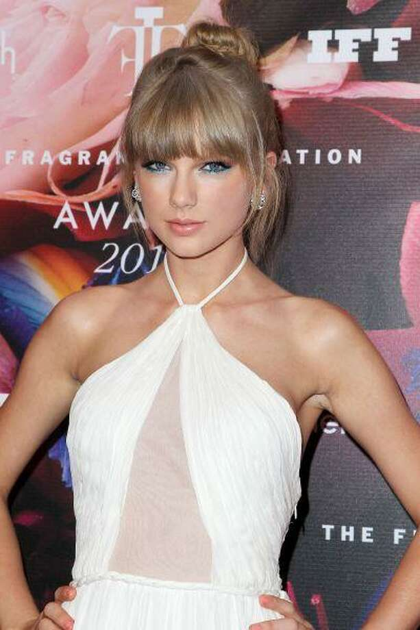 This June 12, 2013 photo released by Starpix shows singer Taylor Swift at The Fragrance Foundation Awards at Lincoln Center's Alice Tully Hall in New York. Swift was honored as Fragrance Celebrity of the Year at the Fragrance Awards. She has three signature fragrances, including the recently released Taylor by Taylor Swift. In 2011, her Wonderstruck was the top-selling celebrity fragrance. (AP Photo/Starpix, Amanda Schwab) Photo: AP / STARPIX