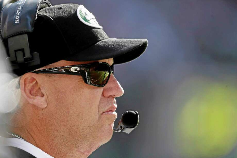 New York Jets head coach Rex Ryan stands on the sideline during the second half of Sunday's game against the New England Patriots in East Rutherford, N.J. Photo: Seth Wenig — The Associated Press  / AP