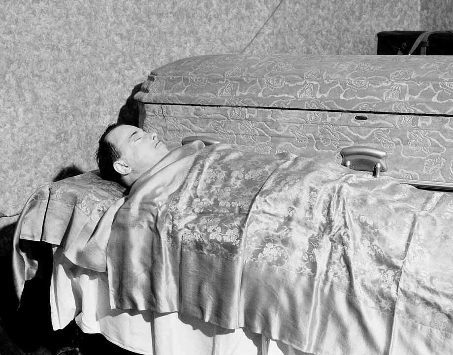 The body of slain outlaw John Dillinger lies in state at the Harvey Funeral Home in Mooresville, Ind., July 25, 1934.  The body will later be placed in the casket shown in background.  (AP Photo) Photo: ASSOCIATED PRESS / AP1934