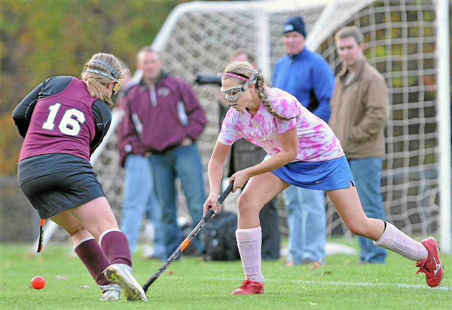 Mercy junior forward Maddie DeRita battles North Haven junior Molly Benson at midfield Wednesday afternoon. DeRita racked up two of the Tigers three goals tying the Indians, 3-3 tie in overtime. Mercy plays their last game of the year against North Branford today at home. Photo: Catherine Avalone — The Middletown Press  / TheMiddletownPress