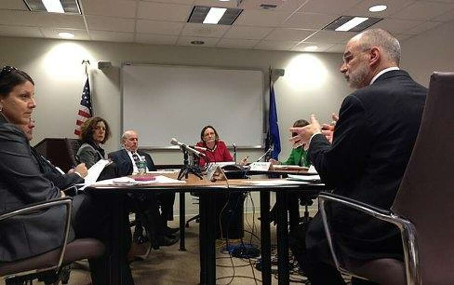 To the right of photo is David Guay, who was appointed by Gov. Dannel P. Malloy to head the Office of Government Accountability. Christine Stuart file photo