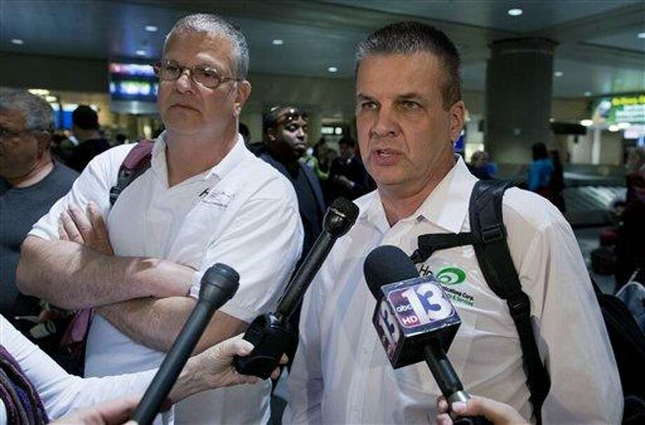 Charlie Restivo, left, and Don Davis of Huntington, N.Y., speak with members of the media after arriving at McCarran International Airport Tuesday in Las Vegas. Davis and Restivo Davis were two of the passengers aboard Jet Blue flight 191 from New York JFK when it was diverted to Amarillo, Texas, after the captain stormed through his plane rambling about a bomb and threats from Iraq Tuesday.  Associated Press Photo: AP / AP
