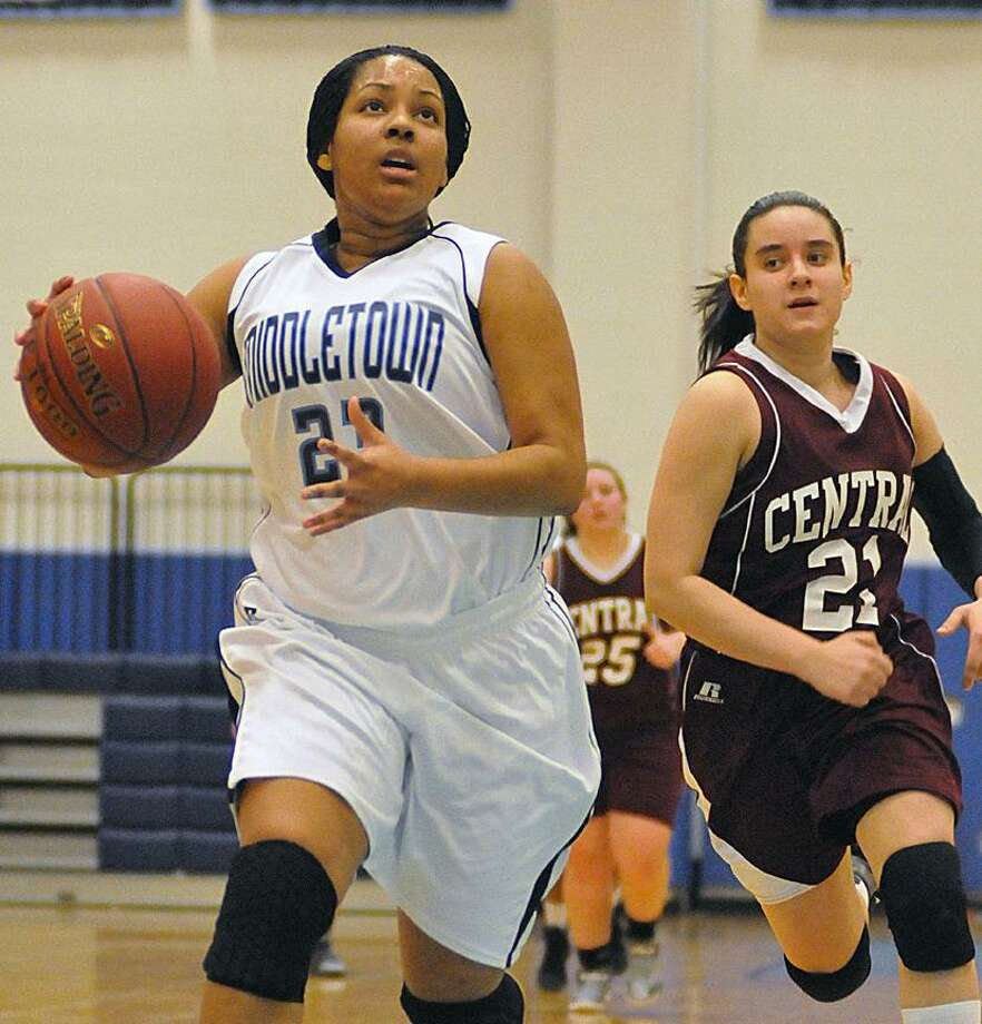Catherine Avalone/The Middletown PressMiddletown junior forward Tamyia King drives past Bristol Central sophomore defender Erika Monsalve Thursday night at the LaBella-Sullivan Gym at MHS. The Middletown Blue Dragons defeated Bristol Central 52-44. / TheMiddletownPress