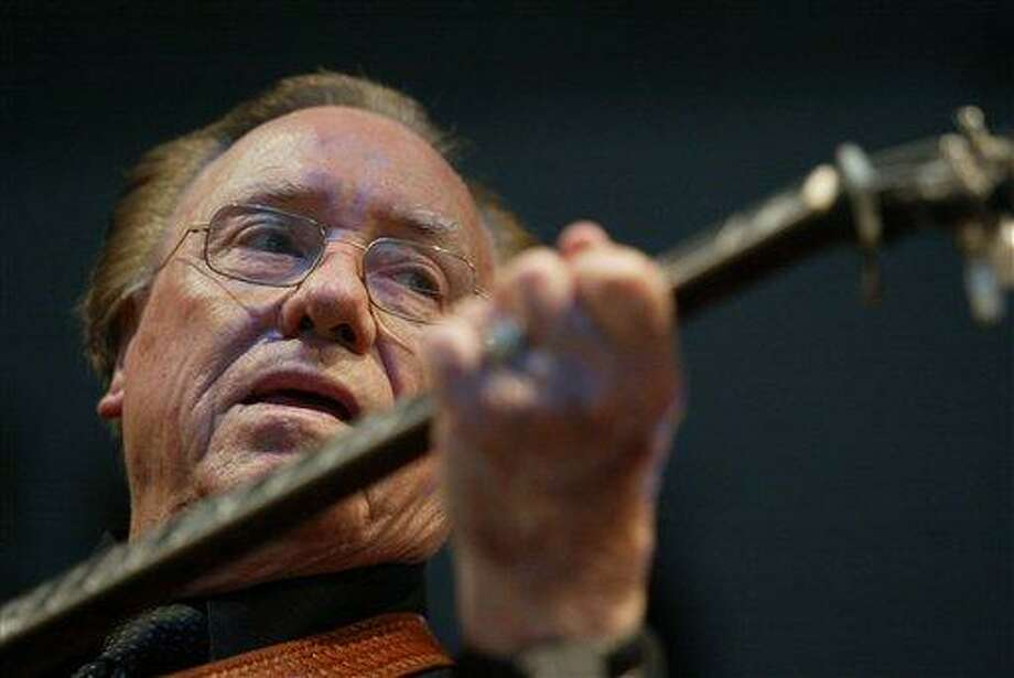 Earl Scruggs, performs at the 2005 Bonnaroo Music & Arts Festival in Manchester, Tenn. Scruggs' son Gary said his father passed away Wednesday morning at a Nashville, Tenn., hospital of natural causes. He was 88. Associated Press Photo: AP / AP2005