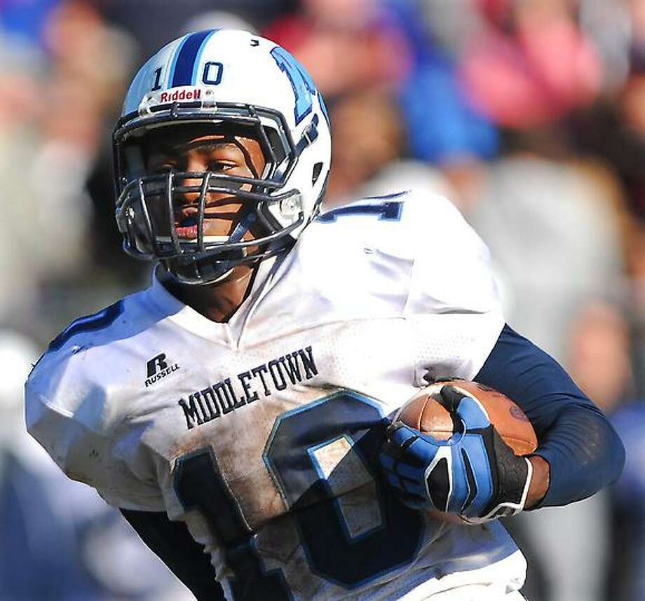 Catherine Avalone/The Middletown Press Xavier defeated Middletown, 41-14 in the fourteenth annual Thanksgiving Day game at Corwin Stadium at Wesleyan University Thursday morning. Pictured, Middletown senior DeJavon Green.