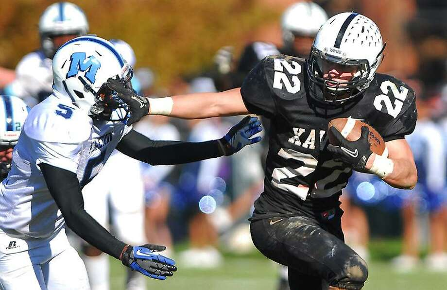 Catherine Avalone/The Middletown Press Xavier defeated Middletown, 41-14 in the fourteenth annual Thanksgiving Day game at Corwin Stadium at Wesleyan University Thursday morning. Pictured, Xavier senior Kris Luster.