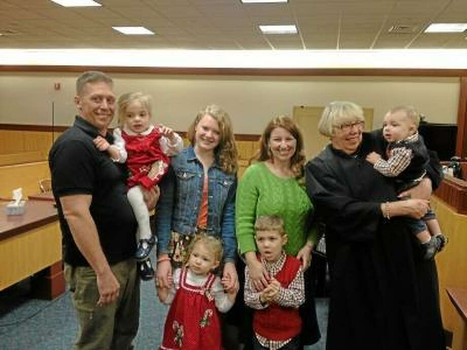 Judge Constance Epstein with the Cioto family following the finalized adoption of 7-month-old Nicholas. He joins biological siblings Anthony, Kathleen and Isabella and 13-year-old Ashley. Jenn and Marc Cioto adopted all four siblings to keep them together. Lauren Sievert/Middletown Press