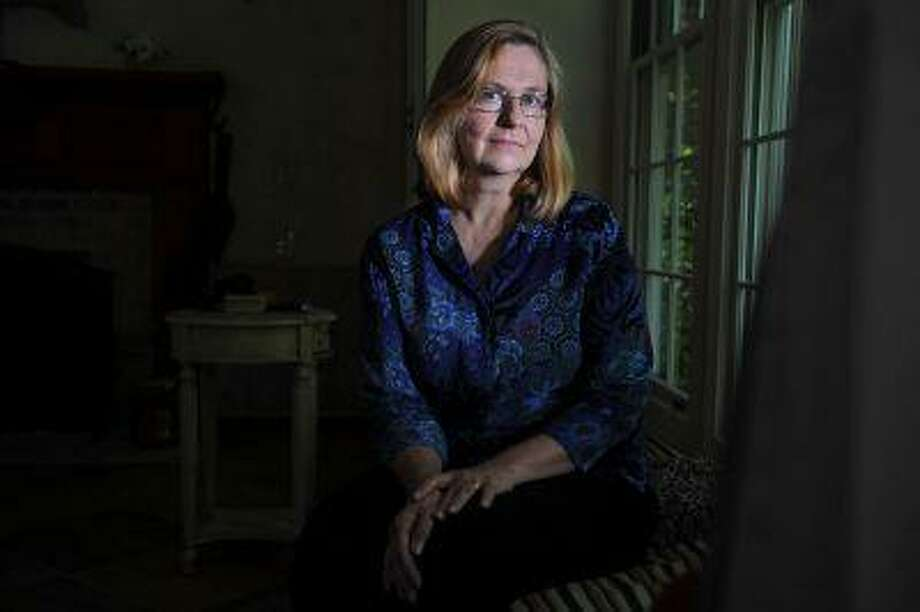 Susan Hasler, seen in this May 22, 2013, photo at her home in Singers Glen, Va., worked for the CIA for 21 years. She left partly because of the long and unpredictable hours. Some have pushed the agency to address work-life balance issues. Photo: The Washington Post / The Washington Post