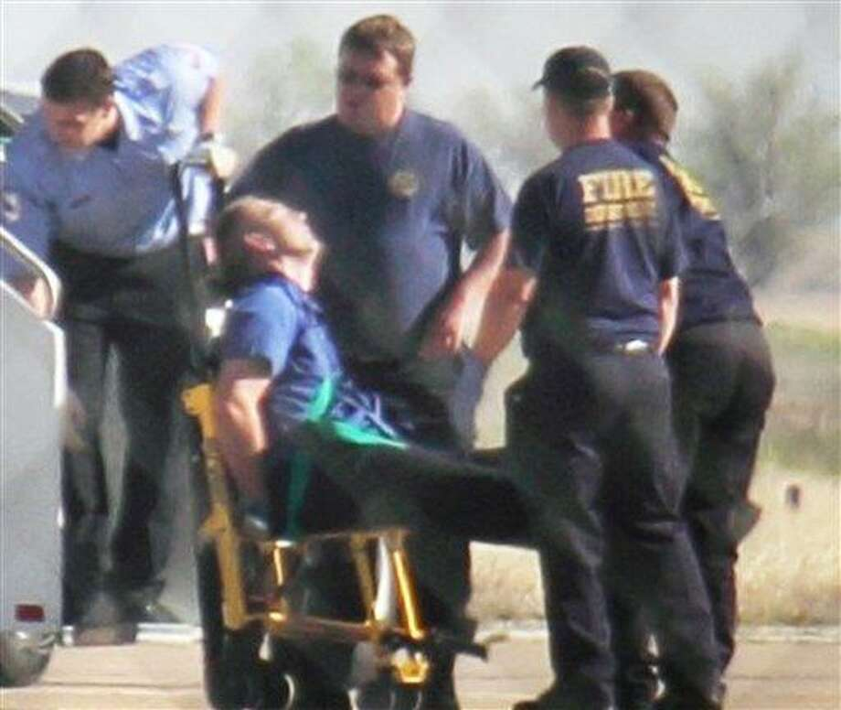 """Emergency workers tend to a JetBlue captain who had a """"medical situation"""" during a Las Vegas-bound flight from JFK International airport Tuesday in Amarillo, Texas. Passengers said the pilot screamed that Iraq or Afghanistan had planted a bomb on the flight, was locked out of the cockpit and then tackled and restrained by passengers. The pilot who subsequently took command of the aircraft elected to land in Amarillo at about 10 a.m., JetBlue Airways said in a statement.  Associated Press Photo: AP / AP"""
