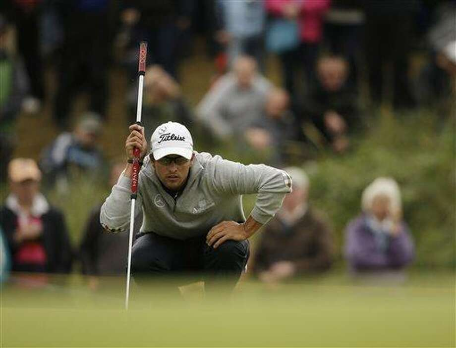 Adam Scott of Australia lines up a putt on the sixth green at Royal Lytham & St Annes golf club during the second round of the British Open Golf Championship, Lytham St Annes, England, Friday, July 20, 2012. (AP Photo/Tim Hales) Photo: AP / AP