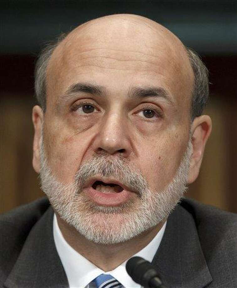 In this file photo, Federal Reserve Board Chairman Ben Bernanke testifies on Capitol Hill in Washington earlier this month. Bernanke says the U.S. job market remains weak despite three months of strong hiring and that the Federal Reserve's existing policies will help boost growth.  Associated Press Photo: AP / AP