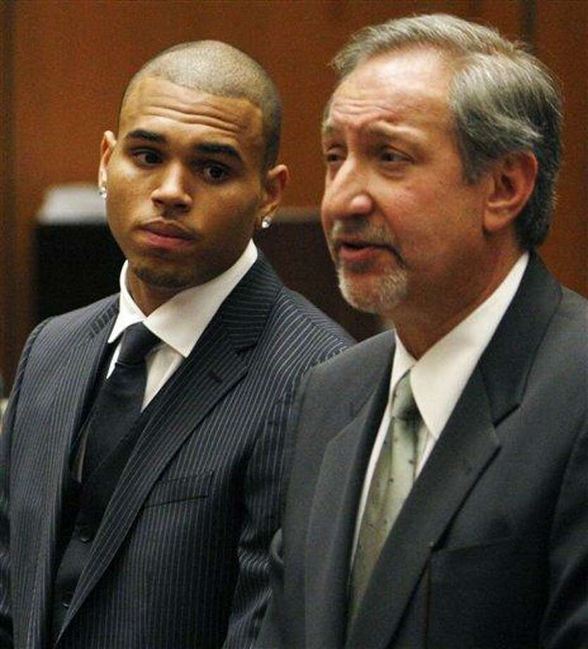 FILE - In this Aug. 25, 2009 file photo, Chris Brown looks on alongside his attorney Mark Geragos during his sentencing for assaulting his girlfriend Rihanna, at Los Angeles County Superior Court in Los Angeles. Brown returns to a Los Angeles court on Wednesday, Feb. 6, 2013, for a hearing in which prosecutors want a judge to revoke his probation and order him to re-do his community labor because of concerns about the accuracy of records provided by Virginia authorities. Brown remains on probation for the 2009 beating of Rihanna. (AP Photo/Rick Loomis, Pool, File) Photo: AP / POOL LA TIMES
