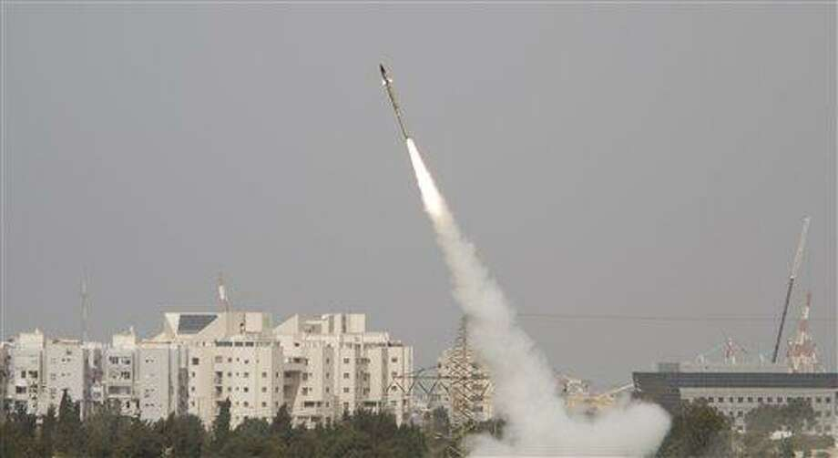 """A rocket is launched Monday from the Israeli anti-missile system known as """"Iron Dome"""" in order to intercept rockets fired by Palestinian militants from the Gaza Strip in the city of Ashdod in southern Israel. The Israeli military said it carried out nine air attacks against rocket-launching sites and a weapons storage facility early Monday.  Associated Press Photo: ASSOCIATED PRESS / AP2012"""