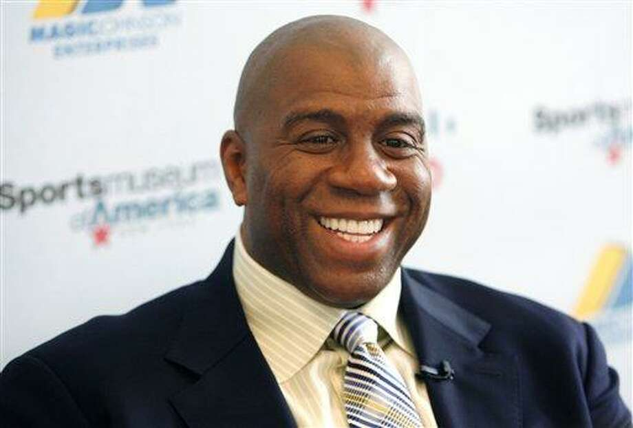 Basketball legend turned entrepreneur Magic Johnson tours the Sports Museum of America in New York in 2008. A group that includes former Lakers star Magic Johnson and longtime baseball executive Stan Kasten agreed Tuesday to buy the Los Angeles Dodgers from Frank McCourt for $2 billion. Associated Press Photo: AP / AP2008