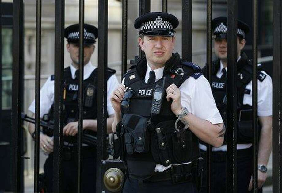 Police officers keep watch Wednesday at Downing Street in Westminster near the London 2012 beach volleyball venue in London. Britain's spy agencies and police have planned for a dizzying array of security nightmares surrounding the Olympics. Associated Press Photo: AP / AP