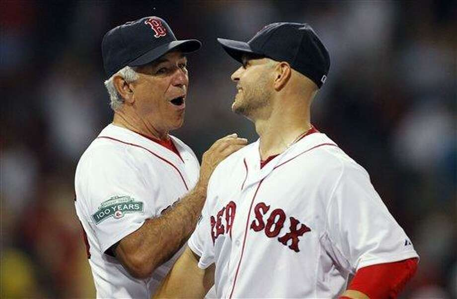 Boston Red Sox manager Bobby Valentine, left, and Cody Ross celebrate after defeating the Chicago White Sox 10-1 in a baseball game in Boston, Wednesday, July 18, 2012. (AP Photo/Michael Dwyer) Photo: ASSOCIATED PRESS / AP2012