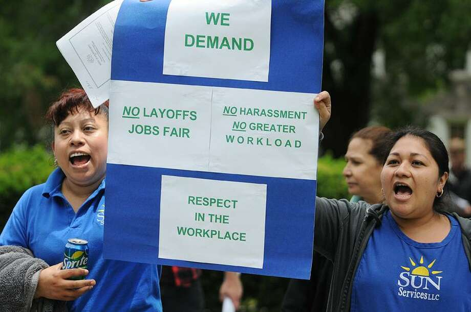 Catherine Avalone/The Middletown PressNew Britain resident Bilma Ramirez, at left and Middletown resident Lucy Forero, custodial workers employed by Sun Servicess, LLC of Shelton which owns the contract for custodial work at Wesleyan University, marched with approximately 40 co-workers at noon to President Michael Roth's home on High Street in protest of poor working conditions. / TheMiddletownPress