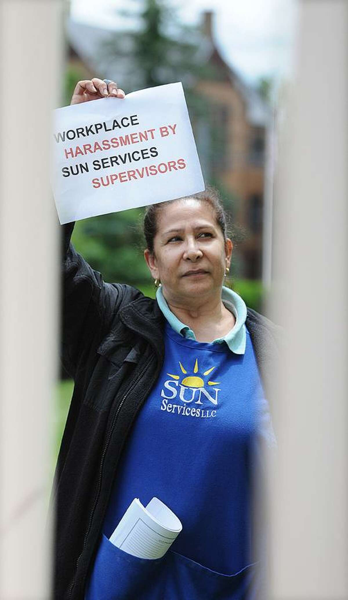 Catherine Avalone/The Middletown PressPhotographed from the entrance of President Michael Roth's home on High Street, New Britain resident Elena Morales, employed by Sun Servicess, LLC of Shelton which owns the contract for custodial work at Wesleyan University, marched from the President's office at college row to his home with approximately 40 co-workers at noon to complaining of poor working conditions.