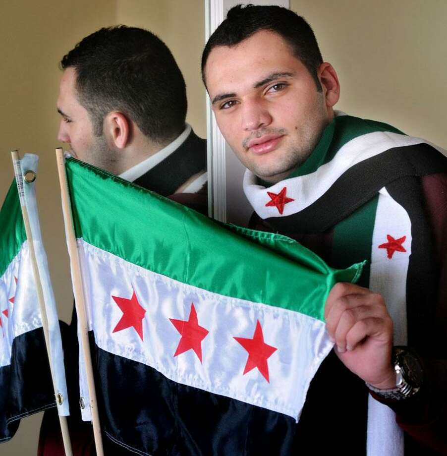 CCSU student and Syrian Abdul Kreiyeh at his Middletown home. Kreiyah and his family left Syria several months ago after harrowing experiences. Mara Lavitt/New Haven Register