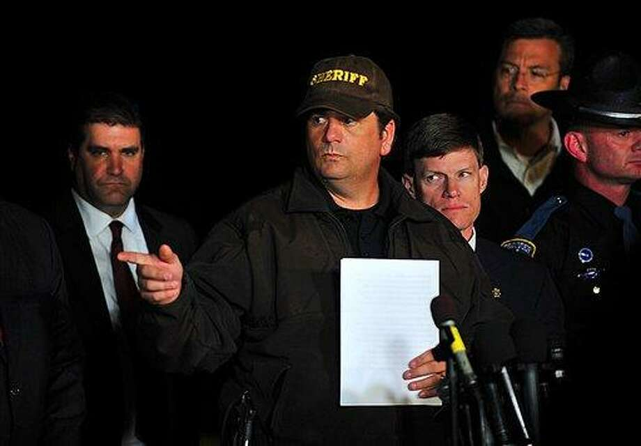 Dale County Sheriff Wally Olsen answers questions from the media about the close of the hostage crisis during a news conference late Monday, Feb. 4, 2013, in Midland City, Ala. Authorities stormed an underground bunker Monday in Midland City, freeing the 5-year-old boy and leaving his captor dead after a week of fruitless negotiations that left authorities convinced the child was in imminent danger. (AP Photo/AL.com, Jay Hare) Photo: AP / AL.com