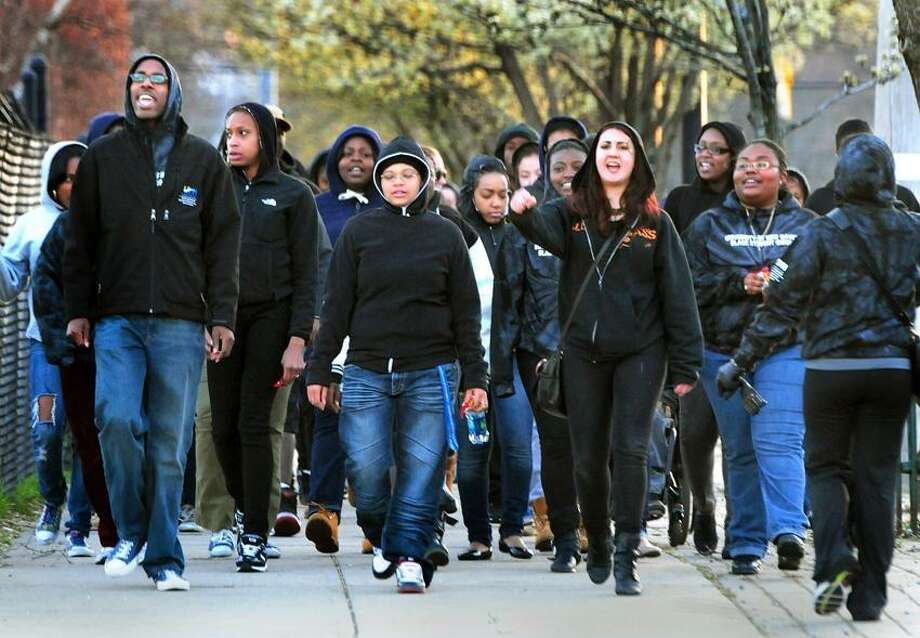 University of New Haven students march from their West Haven Campus to the New Haven Green in a demonstration calling for justice for Trayvon Martin.     Melanie Stengel/Register