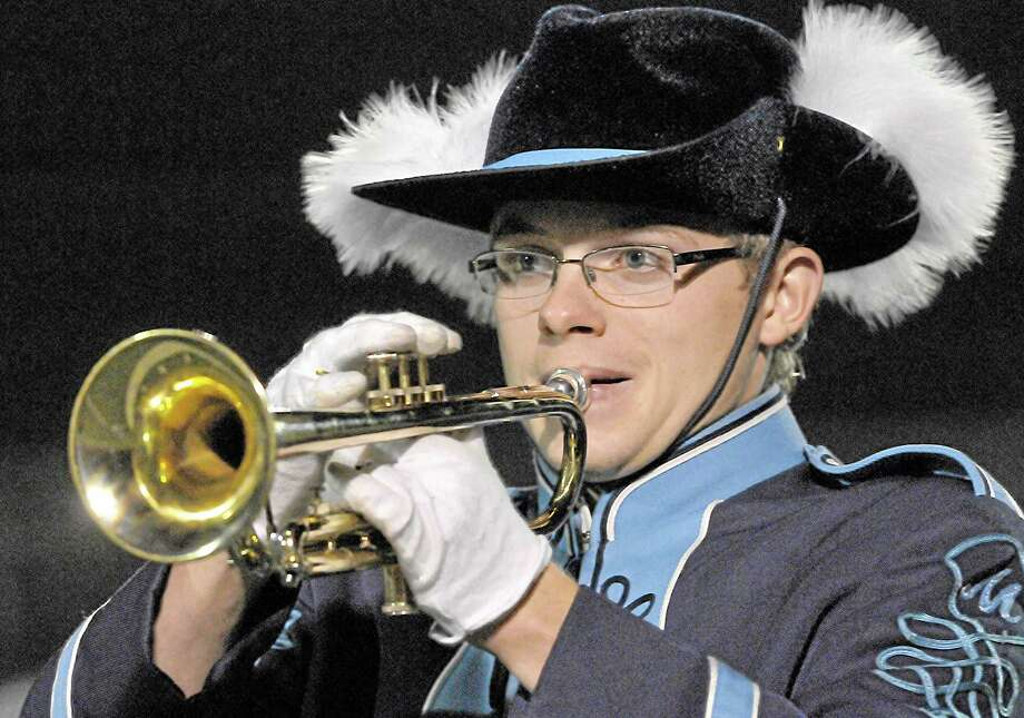 Trumpet player Matt Dagenais, a member of the Middletown High School marching band plays during the halftime show at the Rosek-Skubel Stadium in Middletown. Photo: Catherine Avalone - The Middletown Press   / TheMiddletownPress