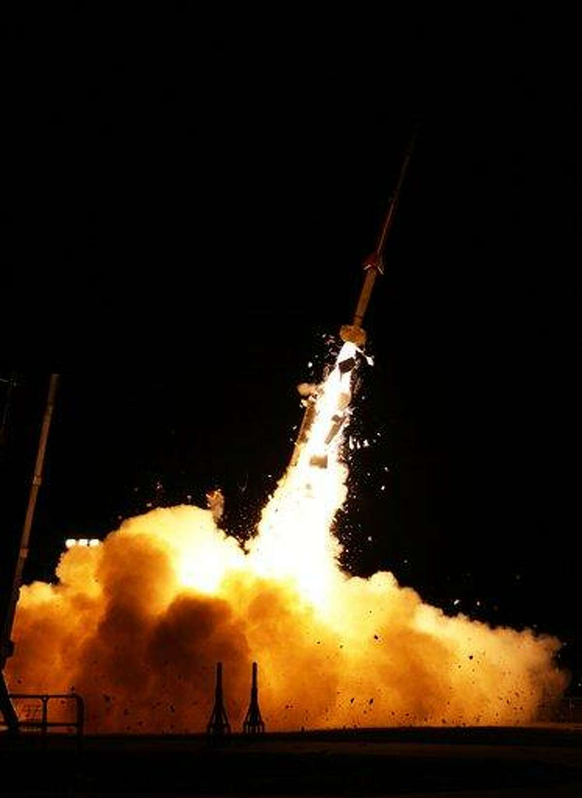 In this photo provided by NASA, a sounding rocket launches from NASA's Wallops Flight Facility in Wallops Island, Va., Tuesday as part of the Anomalous Transport Rocket Experiment (ATREX). Five rockets were launched from the site before dawn Tuesday for the ATREX mission to help scientists understand the upper level jet stream, which is located 60 to 65 miles above Earth's surface. Associated Press
