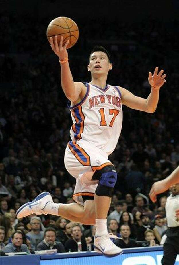 FILE - In this Feb. 4, 2012, file photo, New York Knicks' Jeremy Lin drives to the basket during the second quarter of an NBA basketball game New Jersey Nets at Madison Square Garden in New York. Linsanity could be put to rest in New York when the clock strikes midnight. That's the deadline the Knicks face to match the daunting offer the Houston Rockets have made to Lin, the Harvard point guard who dazzled all of basketball for a brief stretch last season. (AP Photo/Bill Kostroun, File) Photo: AP / FR51951 AP