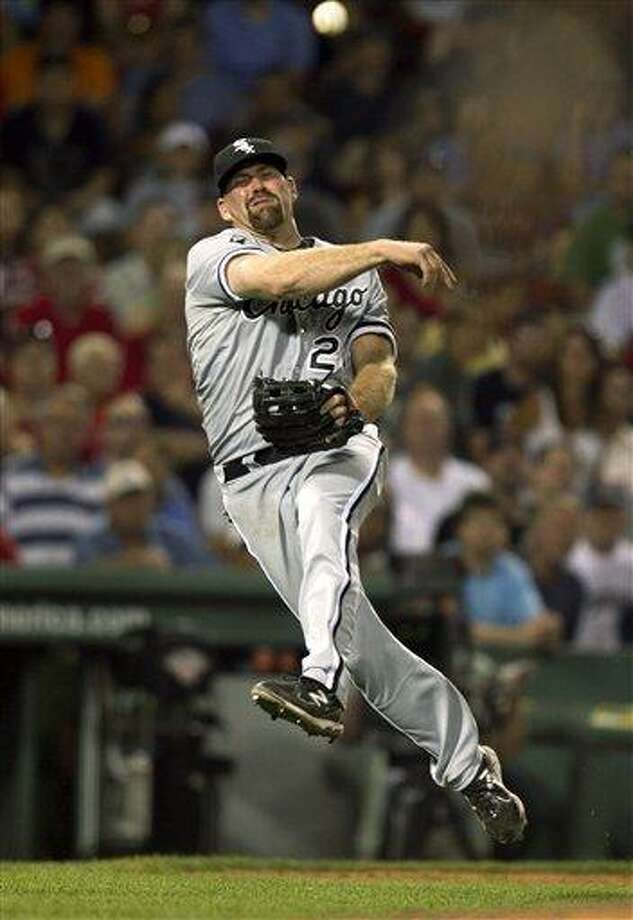 Chicago White Sox's Kevin Youkilis throws to first in an attempt to retire Boston Red Sox's Carl Crawford in the eighth inning of a baseball game at Fenway Park in Boston, Tuesday, July 17, 2012. (AP Photo/Steven Senne) Photo: AP / AP